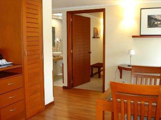Hotel Boutique Confort Suites: Sala de estar suite superior!