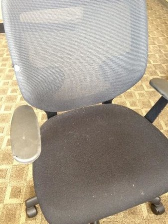 Hyatt Regency Louisville: torn, dirty desk chair