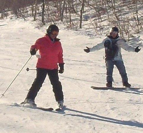 Snowbasin Resort: Son giving encouragement to his mom the beginner.