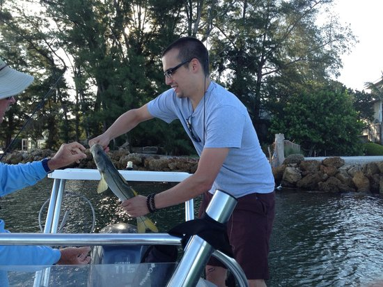 Lucky Dawg Fishing Charters: Our son getting one off the line