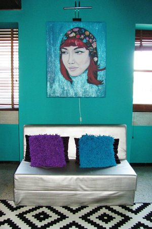 "Lisbon Short Stay Apartments Baixa: Painting of Gina (""couch"" opens into an additional bed"