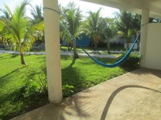 El Milagro Beach Hotel and Marina: hammocks on the porch outside our room
