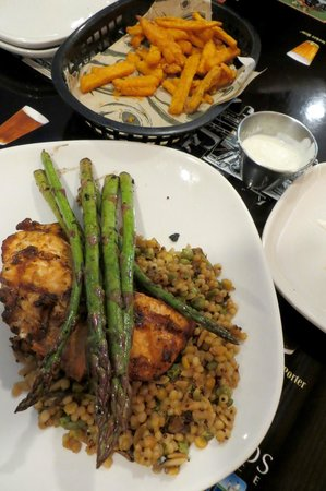 Flyer's: Sweet potato fries and grilled salmon with asparagus over herb-cooked couscous