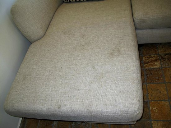 Asfiya Hotel : Couch with unknown stains