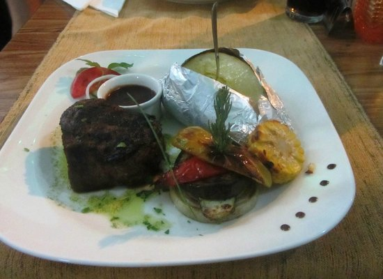 American Grill Restaurant & Bar: Tenderloin steak medium rare with jacket potato and grilled vegetables