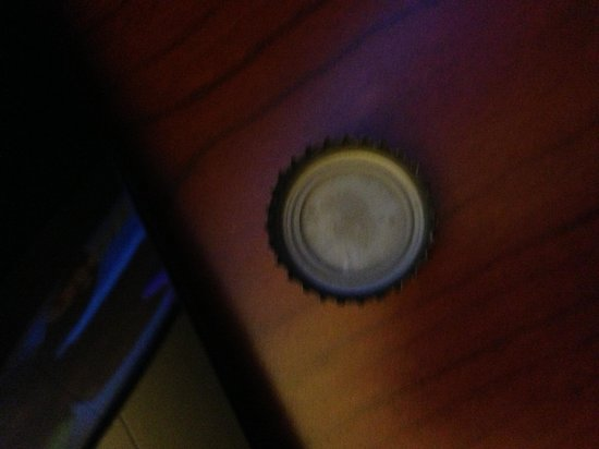 "Clarion Hotel: Beer cap that my one year old daughter had in her mouth.  She found it on the floor in our ""clea"