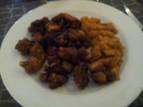 Extremadura: Cuchifrito de Cabrito con patatas revolconas