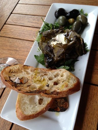 The Heathman Hotel Kirkland: Grilled grape leaves stuffed with goat cheese and served with artisanal bread
