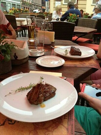 Steiku Haoss: a couple of the Steaks, you can just about see the gleaming knives and forks