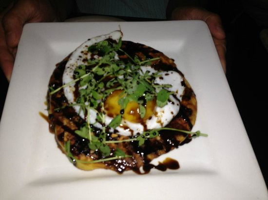 Strip Club Meat and Fish : appetizer special: blueberry and thyme pancake with duck egg and pea shoots - Amazing!