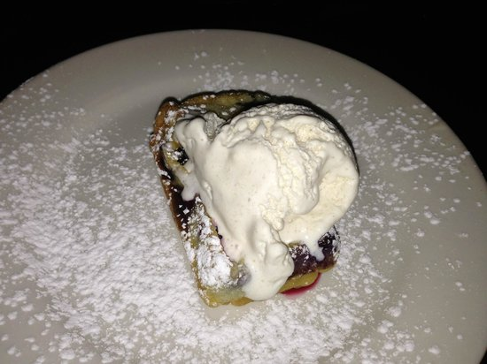 Strip Club Meat and Fish : Dessert - blueberry and cherry clafoutis with ginger ice cream