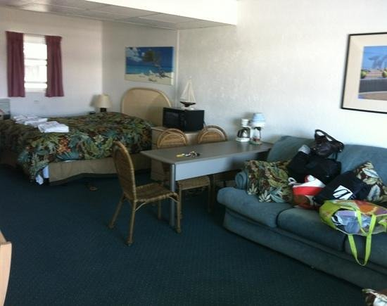 Cara Mara Resort Condominiums: dingy couch, out dated furniture, and dark rug