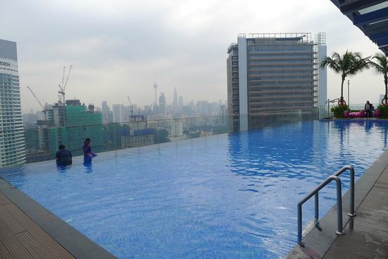 Aloft Kuala Lumpur Sentral: View of pool - KL City skyline in the background