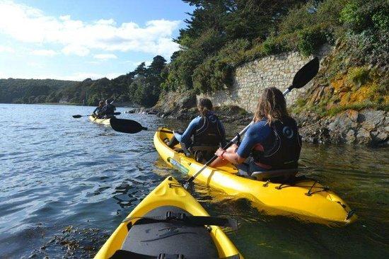 Group kayaking Helford River