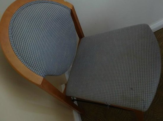 Ibis Lincoln: the one comfortable chair - grubby - shabby