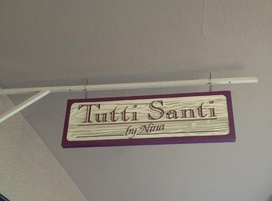Tutti Santi by Nina: outside sign
