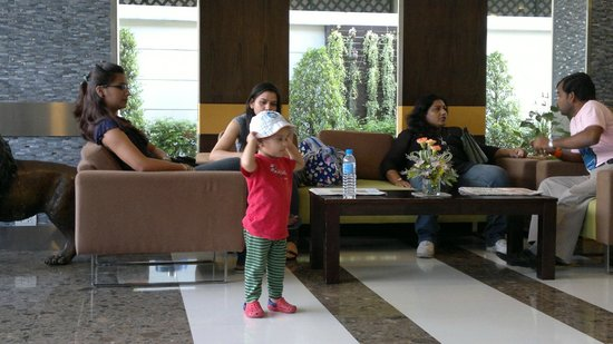 Adelphi Suites Bangkok : Daughter enjoying with my friends at the lobby.