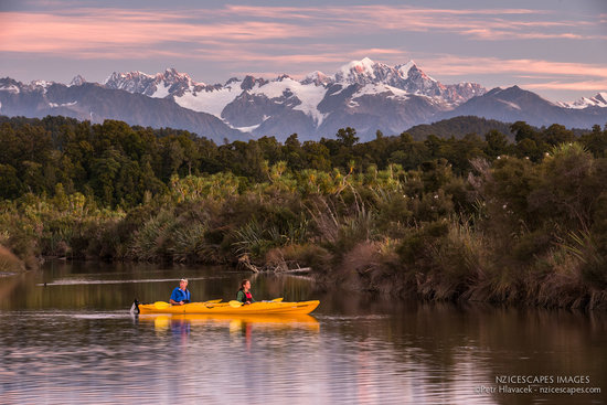 Okarito Kayaks: Okarito Lagoon with Mount Cook in background