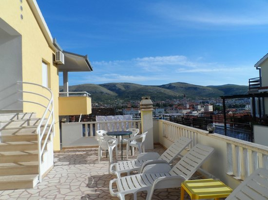 Apartments Kasalo: communal side terrace. stairs on the left is the entrance to the apartment