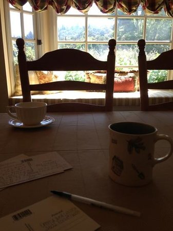 Oleander House B&B: enjoying coffee while writing postcards in the dining room