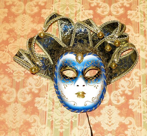 Antica Locanda al Gambero: One of the masks - on the wall of the breakfast room