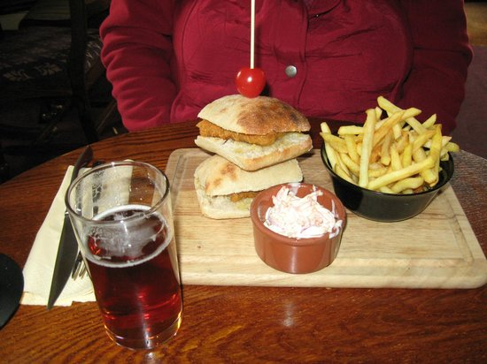 Golden Cross: Our delicious fish sandwhich with chips, coleslaw and ale