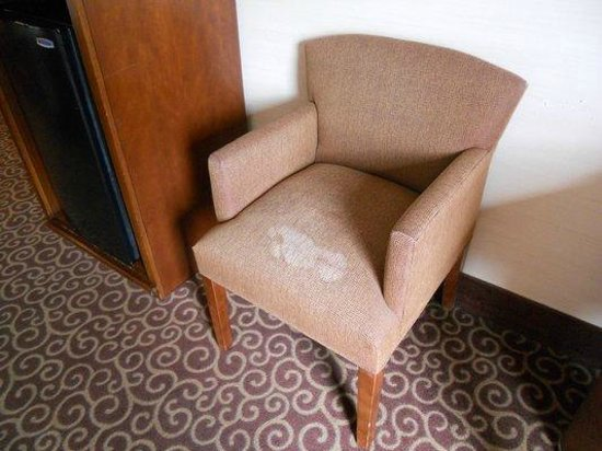 Hampton Inn Sheridan: upholstered side chair badly stained