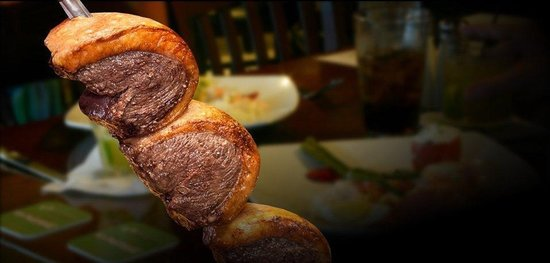 Ragab Brazilian & International Cuisine: We offer a variety of meats brought to you by skewer and carved for you table side