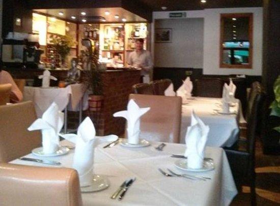 Kadai & Naan: Main restaurant with bar in background