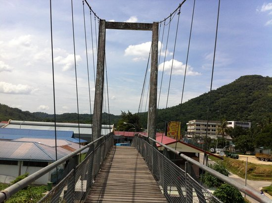 Tamparuli Suspension Bridge: The bridge with Tamparuli Town in the background