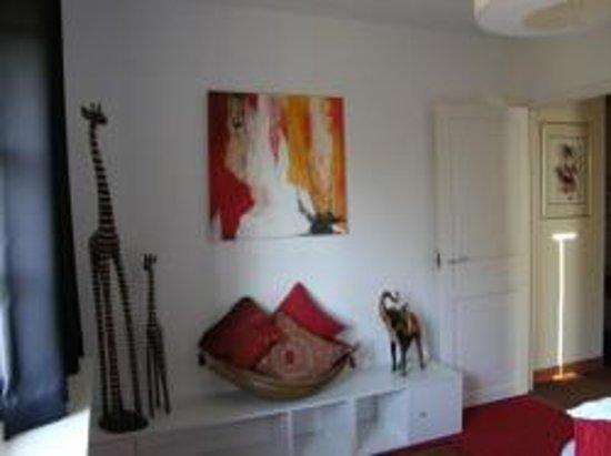 Le Chartil Des Arts : espace couchage de la suite