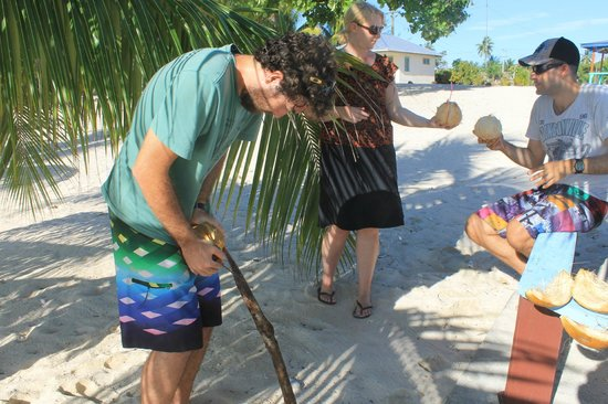 Falealupo Beach Fales: Husking fresh coconuts!