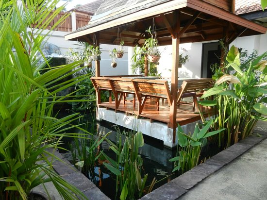 Phuket Gay Homestay - Neramit Hill: breakfast nook on a pond full of coy fish and waterfall