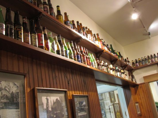Alaskan Brewery and Bottling Company: Wall of bottles from other locations