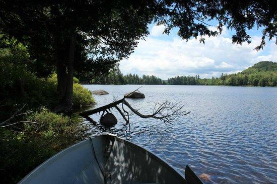 Big Moose Inn : taking a nap on the boat in the Big Moose Lake bay