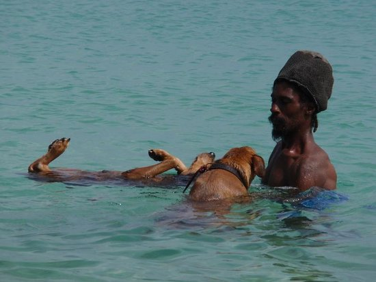 Coyaba Beach Resort : Beach life - local guy with his floating dogs