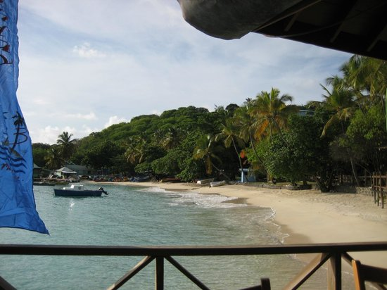 Basil's Bar - Mustique: Beach with fish market at the end