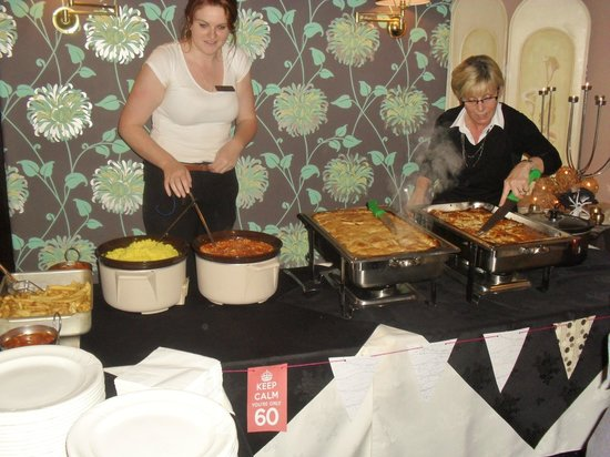 Queen Victoria Pub & Restaurant: The hot buffet with Carol (right) helping out the staff