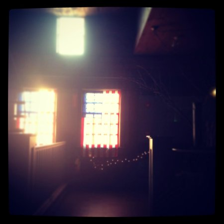 Vine Brook Tavern : Patriotic flags that grace the windows in the upstairs dining room.