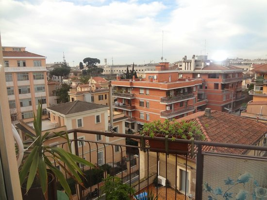 Stelle di San Lorenzo: Balcony View with Rome Termini White Wall in the background