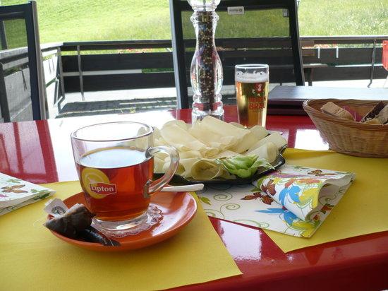 "Sporthotel Habkern: Rum & tea with local ""Hobel Kaese"" - Hobel cheese"