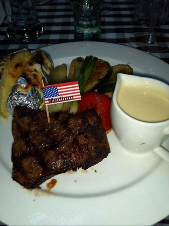 Papa Joe's Saloon & Steakhouse : Steak dinner with baked potato and grilled veggies.