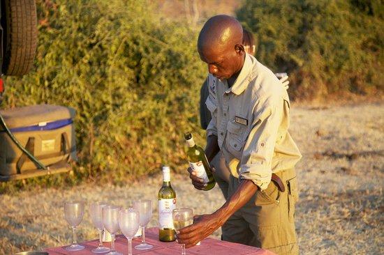 Ngoma Safari Lodge: sunset drink with our guide on jeep safari