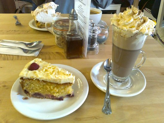 Cafe Latte: Raspberry and white chocolate cake and a hot chocolate