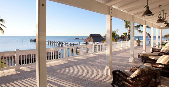 The Caribbean Resort at Sea Isle: Lose yourself in a magnificent, panoramic view of the sea. The massive porch with bronze antique