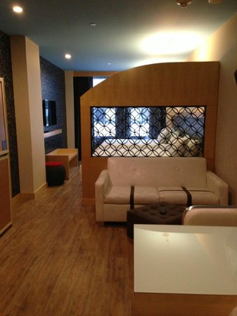 TRYP by Wyndham Times Square South: full sized sleeper sofa (room view with bunk beds secured against wall)
