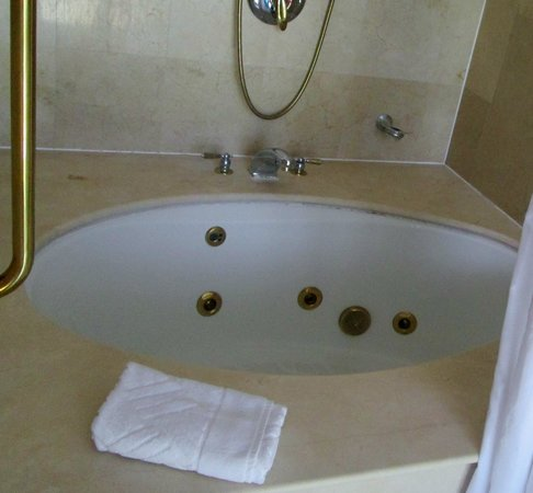Jacuzzi Tub. Grout could use a cleaning in tub. - Picture of ...