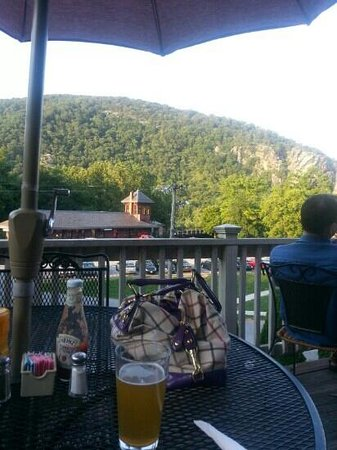 Secret Six Tavern: sitting on the deck over looking the mountains and train station :)