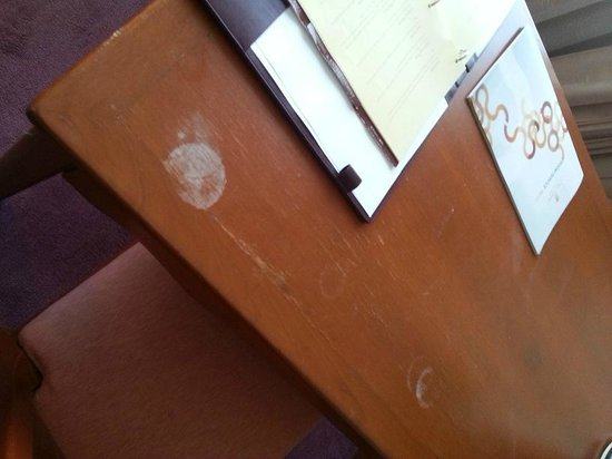 The Twin Towers Hotel: Stains on desk in room