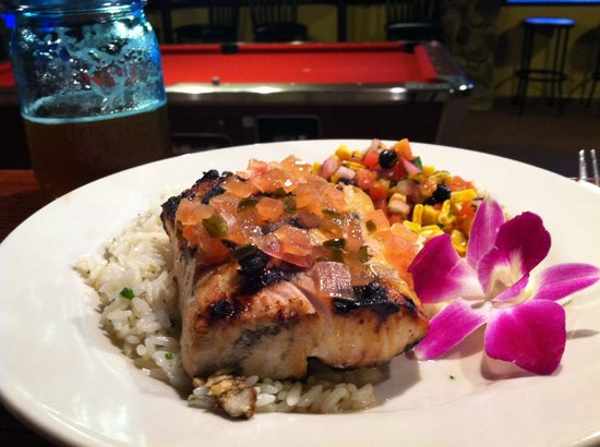 Players Bar & Grille: Grilled Mahi special in a tequila-citrus marinade! Served on cilantro rice with a black bean & r